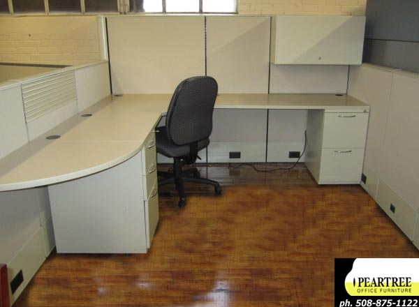 AIS Matrix beige cubicles with multiple height panels, shared teaming tables, overheads, pedestal files and rail tiles.