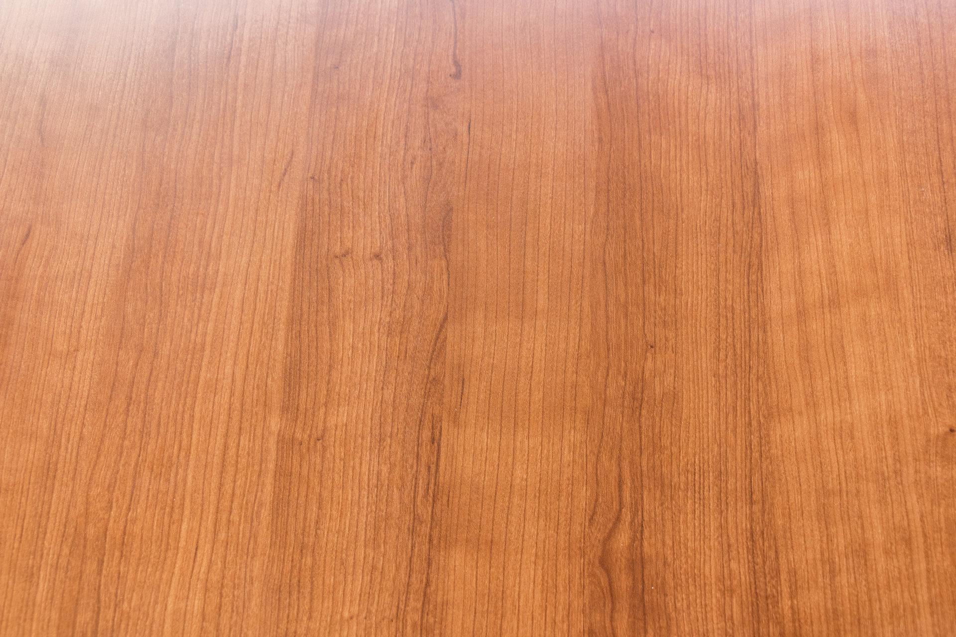 Nienkamper Vox 8′ x 3.5′ Amber Cherry Laminate Tapered Edge Conference Table